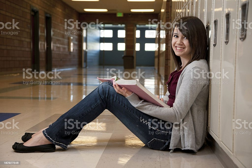 Young Cheerful Girl in School Hallway royalty-free stock photo