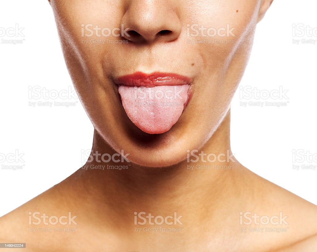 Young cheerful girl showing tongue stock photo