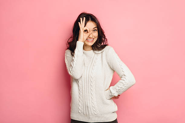 Young cheerful girl showing zero gesture. stock photo