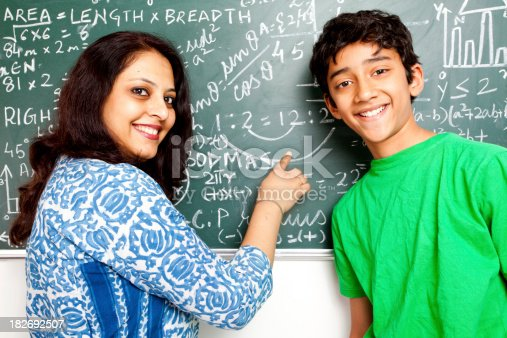 istock Young Cheerful Indian Teacher with her Student 182692507
