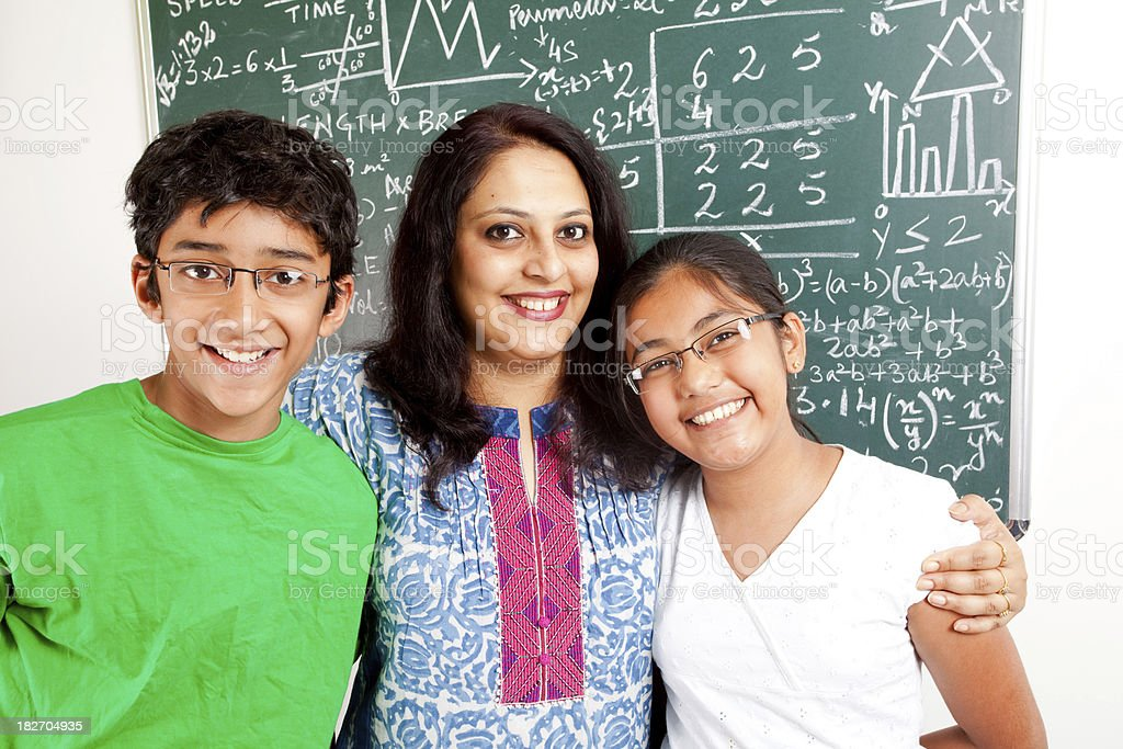 Young Cheerful Indian Teacher with her Students Kids royalty-free stock photo