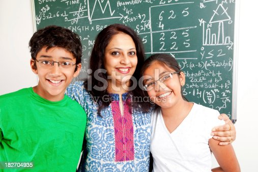 istock Young Cheerful Indian Teacher with her Students Kids 182704935