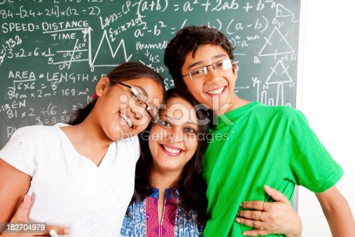 istock Young Cheerful Indian Teacher with her Students Kids 182704979