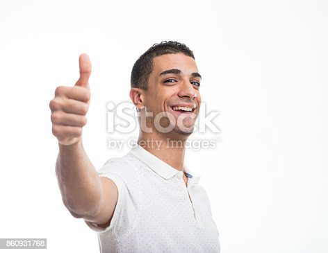 istock Young cheerful man giving thumb up 860931768