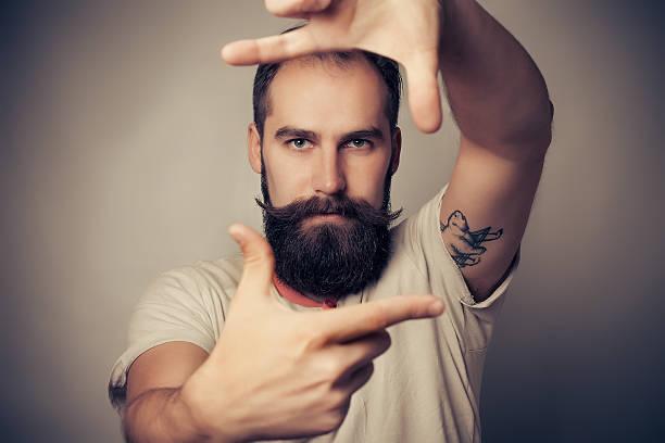 Young cheerful photographer with beard while working in studio picture id497054860?b=1&k=6&m=497054860&s=612x612&w=0&h=iumpdnnq3kub7nstzatek 0f4 1ba6daqmozlcazrpc=