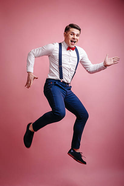 young cheerful stylishly dressed man in a jump stock photo
