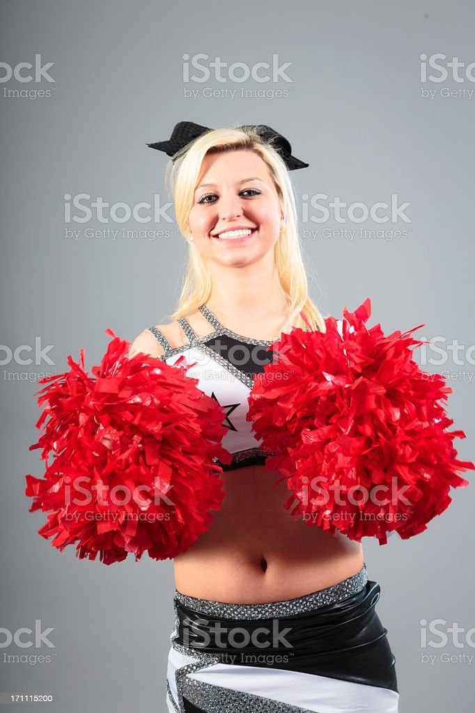young cheerleader on gray background royalty-free stock photo