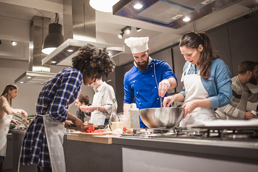istock Young chef assisting a cooking class and explaining some tips and tricks 918473460