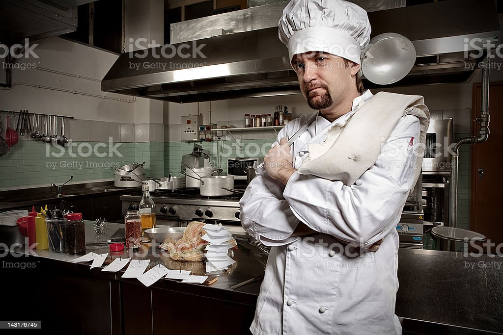 Young chef in his restaurant kitchen royalty-free stock photo