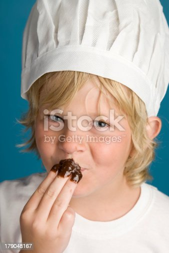 istock Young Chef Makes a Mess with Brownie Batter 179048167