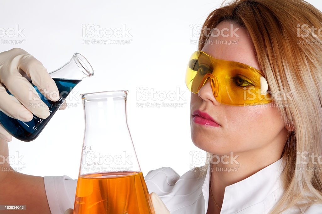 Young Chemist Woman Analyzing Liquids royalty-free stock photo