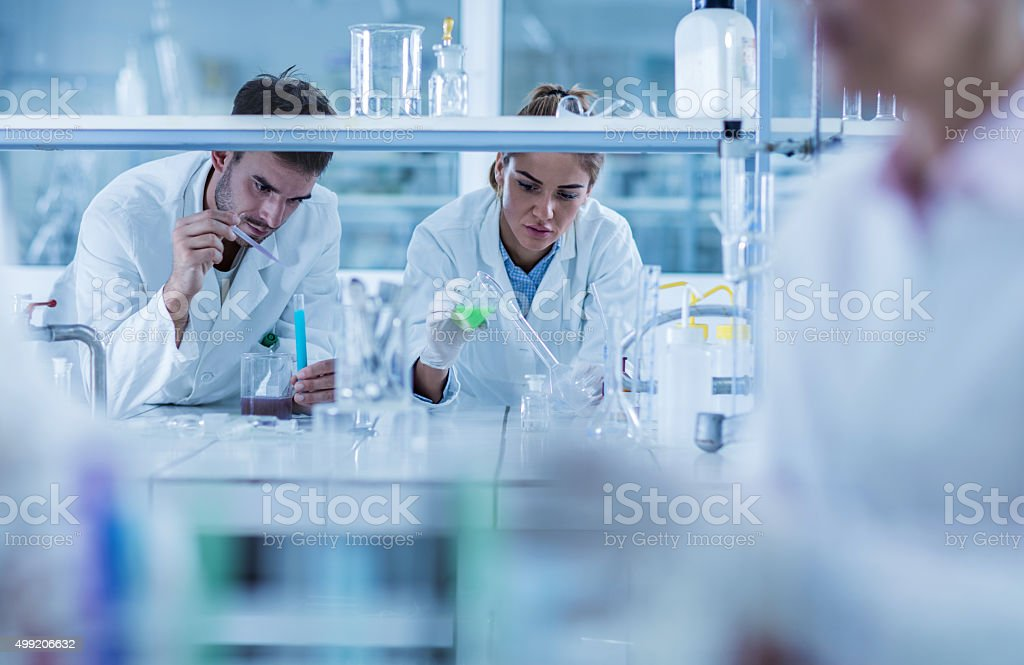 Young chemists working on scientific research in a laboratory. stock photo