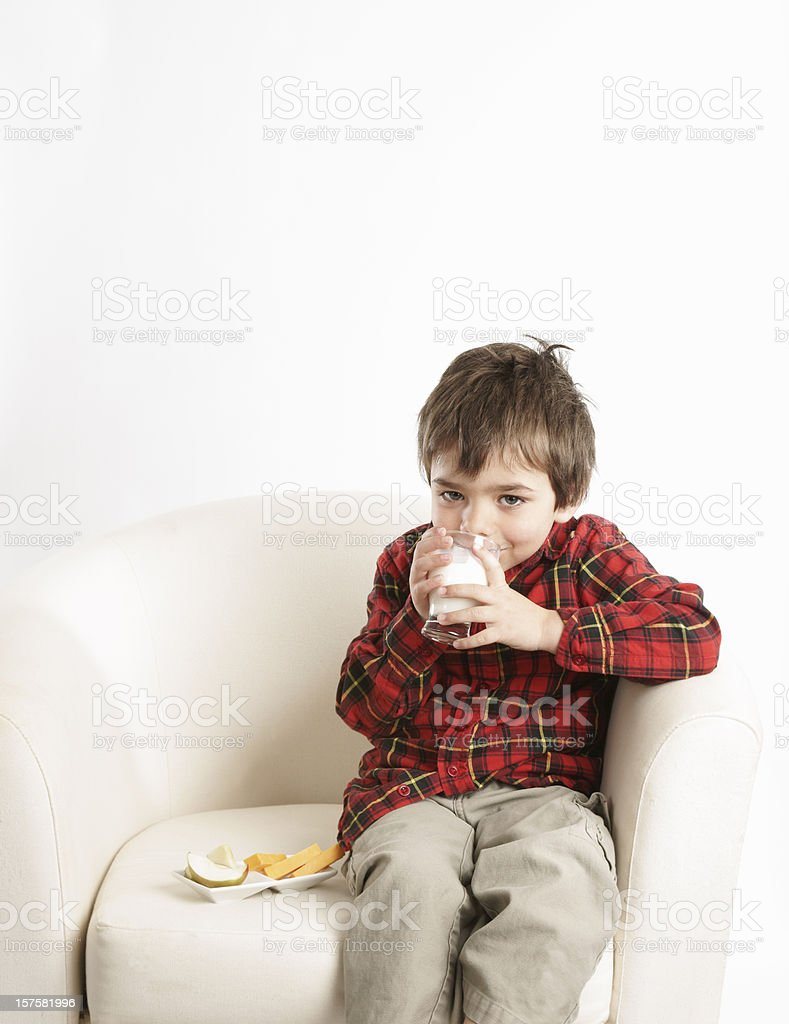 Young child drinking his milk. royalty-free stock photo