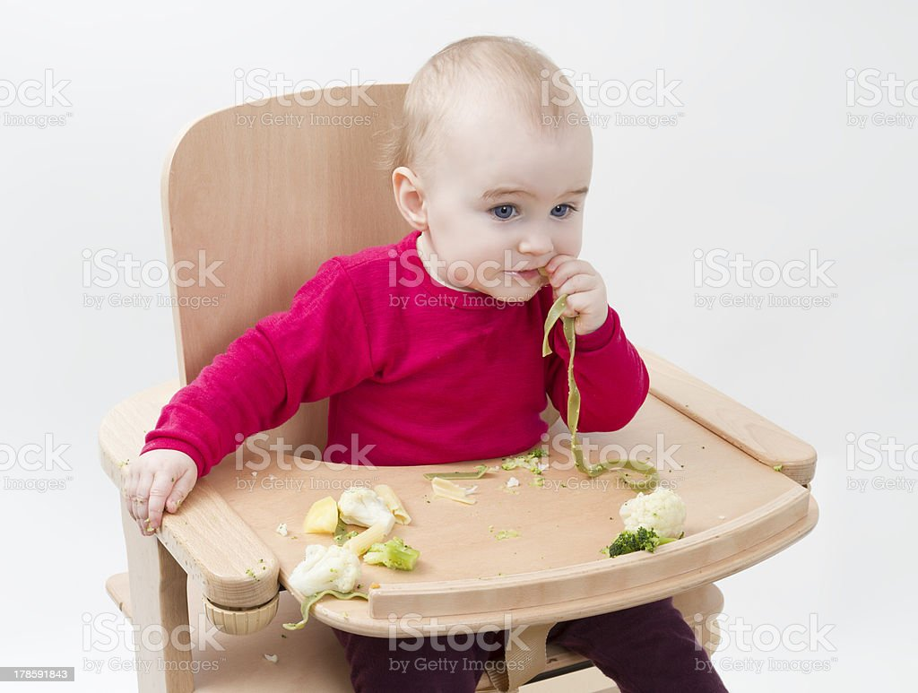 young child eating in high chair royalty-free stock photo