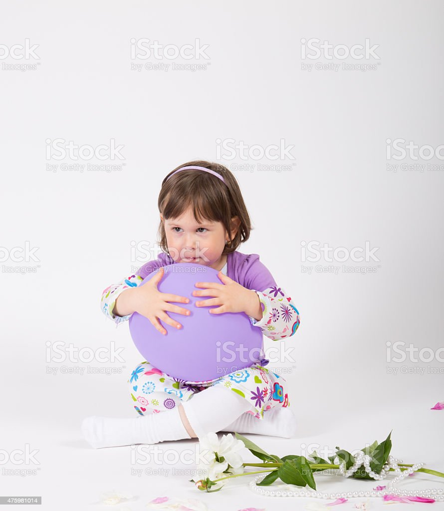 Young child hold a balloon in her hand stock photo