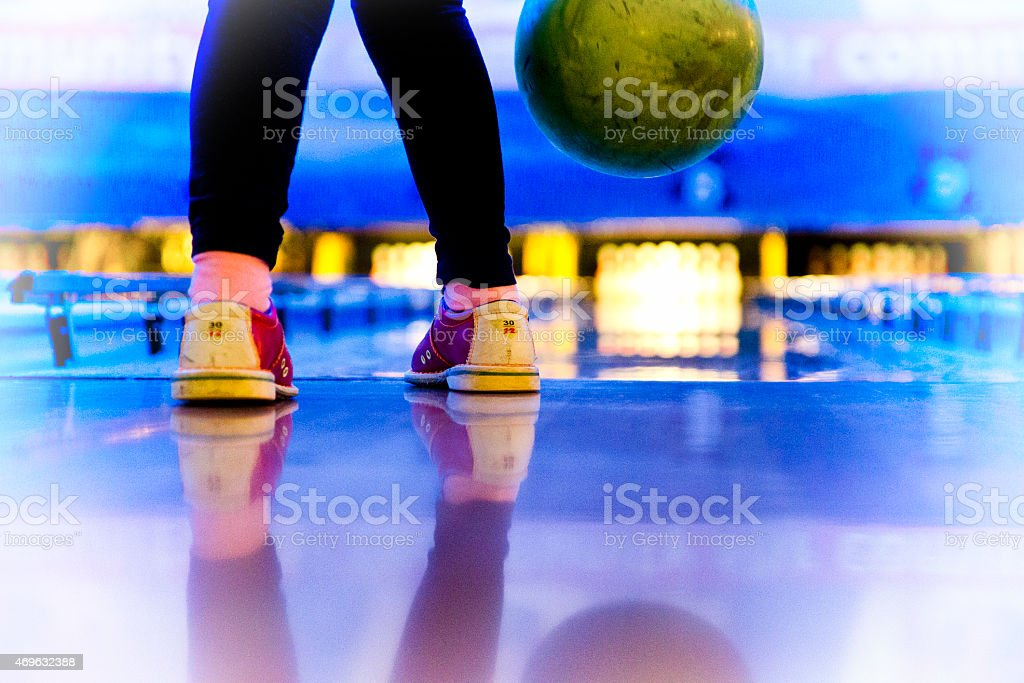 young child in bowling alley