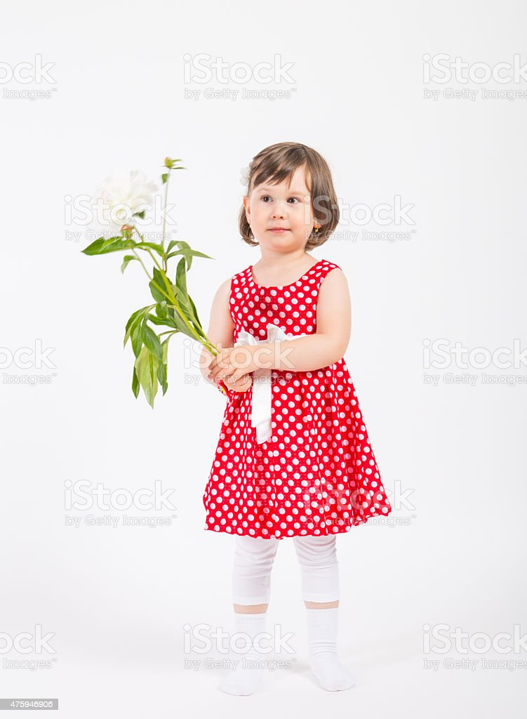 Young child in red clothes with a rose her hand. stock photo