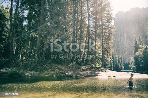istock Young child in Yosemite Valley 615287684