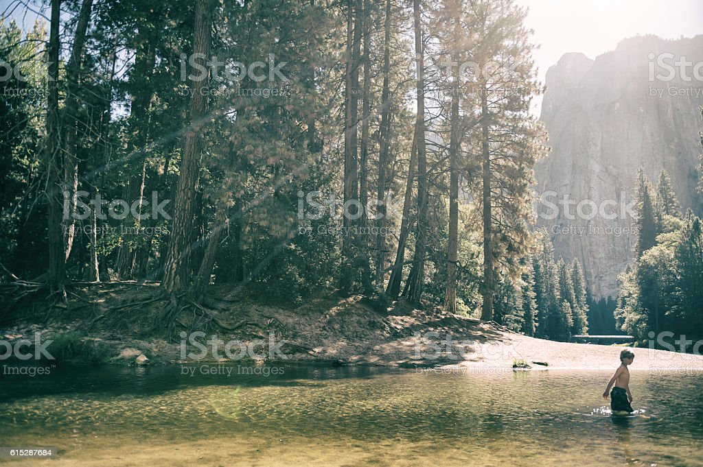 Young child in Yosemite Valley stock photo