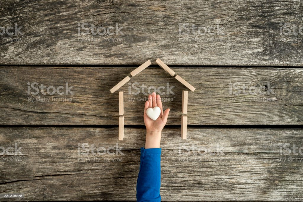 Young child indicating his love for his home stock photo
