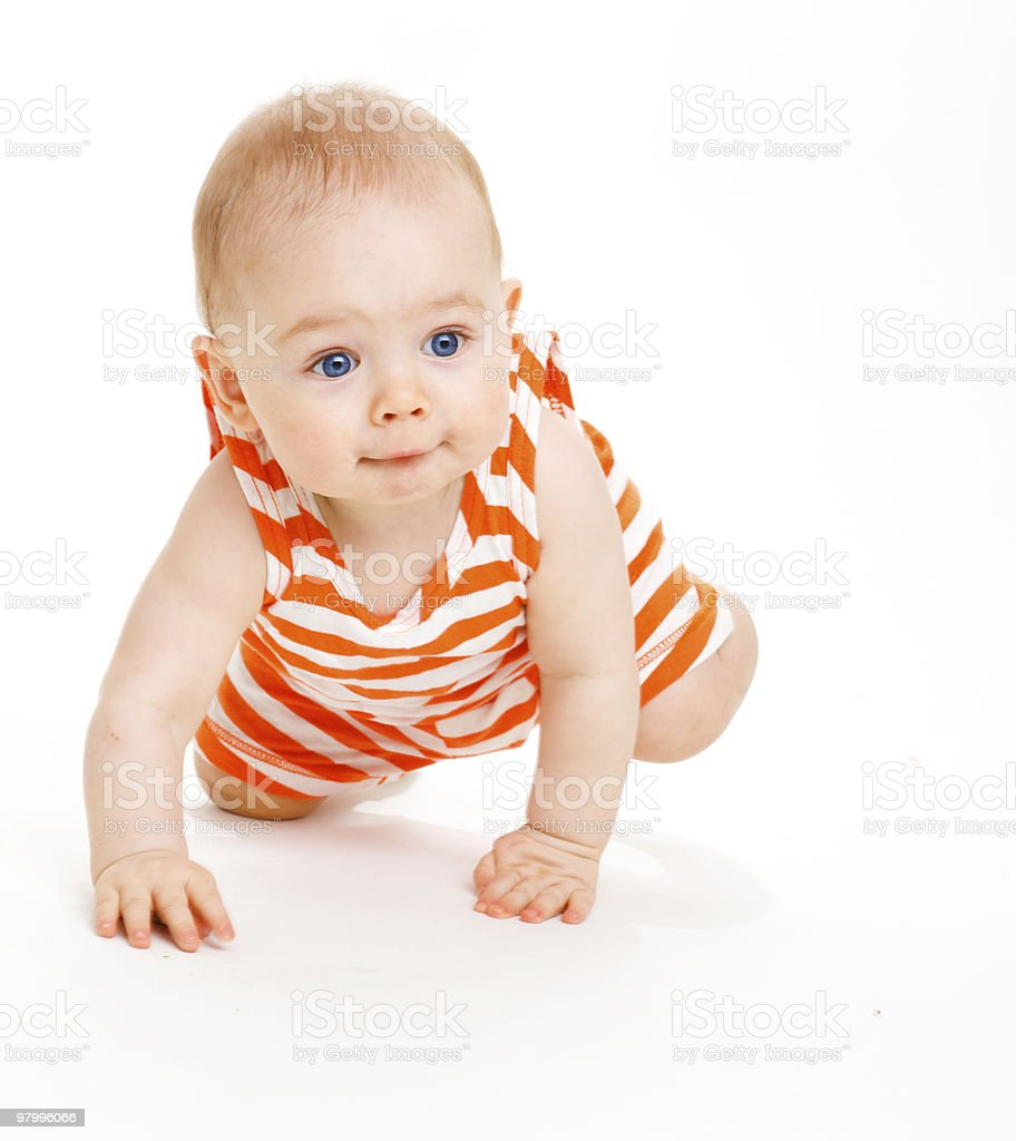 A young child is crawling on the floor  royalty-free stock photo
