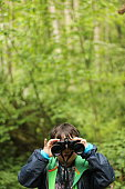 istock A young child looking at the camera with binoculars 1225515967