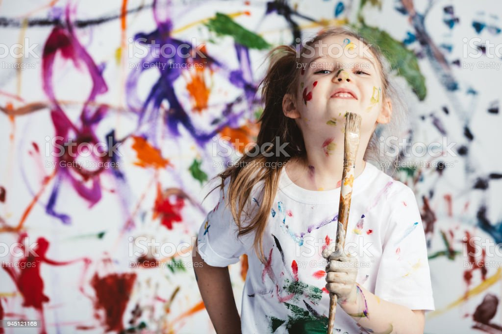 Young child painter standing with a brush royalty-free stock photo
