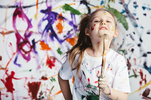 Young Child Painter Standing With A Brush Stock Photo - Download Image Now