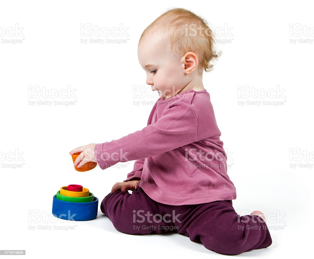 young child playing with colorful toy blocks royalty-free stock photo