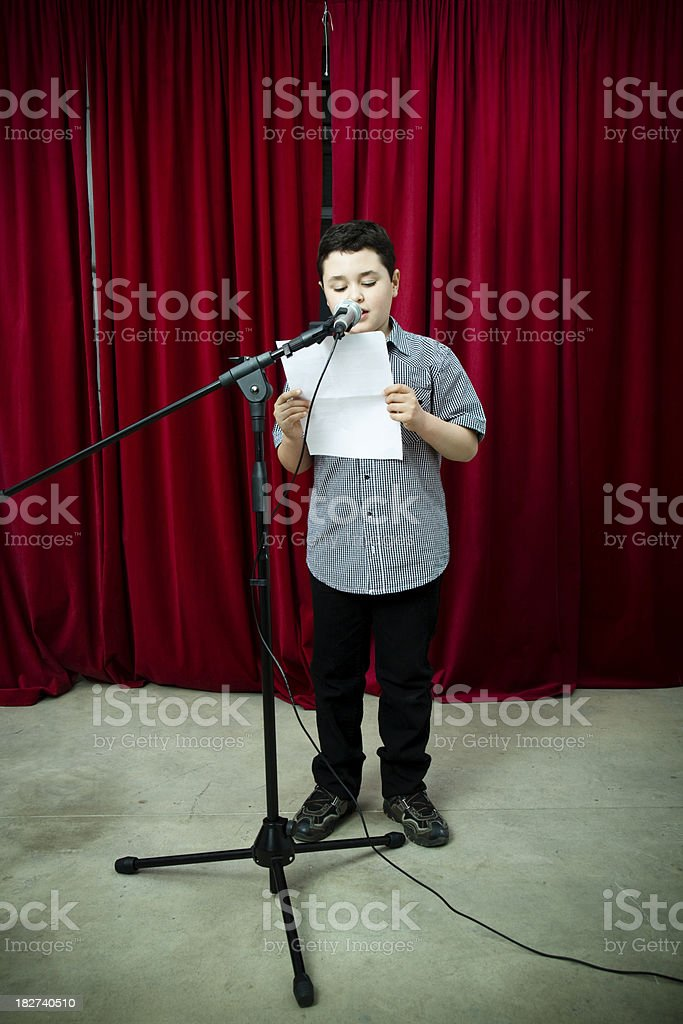 Young child reading a speech stock photo