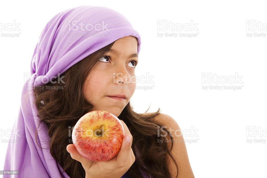 young child showing a red apple royalty-free stock photo
