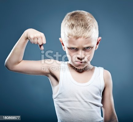 istock Young child showing his muscles 180869577