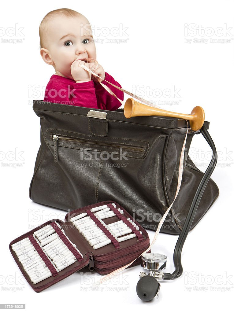 young child sitting in midwifes case stock photo