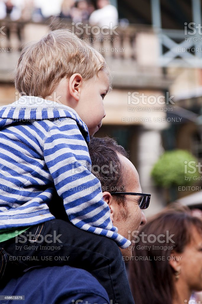 Young Child Sitting on Dads Shoulders royalty-free stock photo