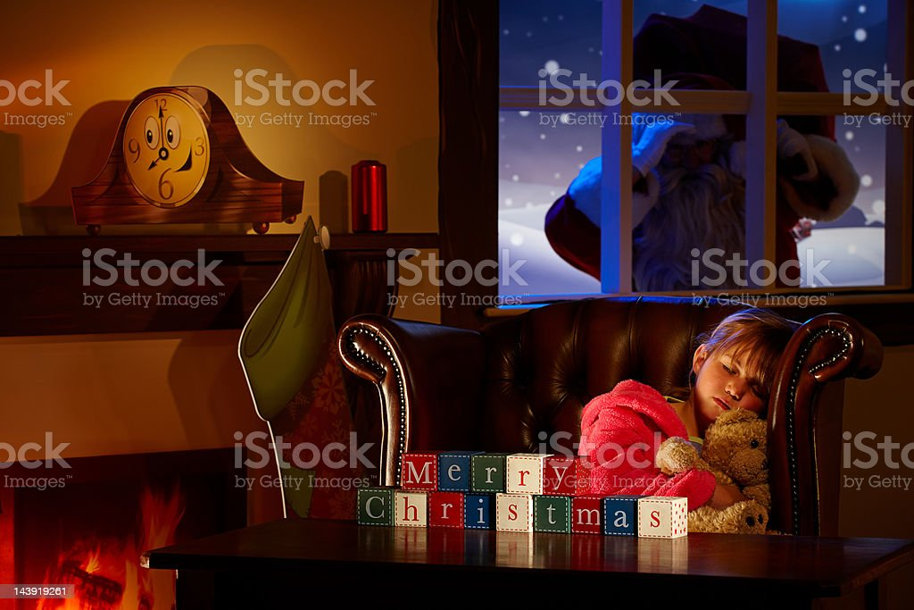 Young child sleeping on armchair while waiting for  Santa. royalty-free stock photo