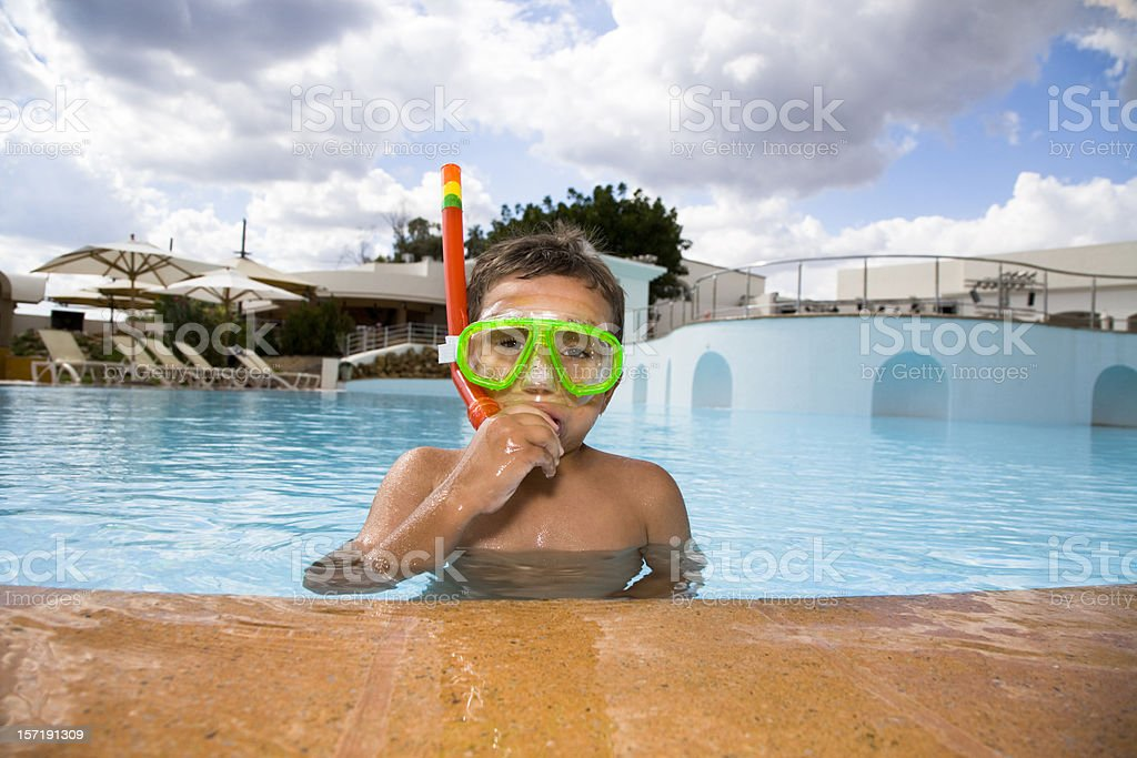 young child snorkeling in swimming pool royalty-free stock photo