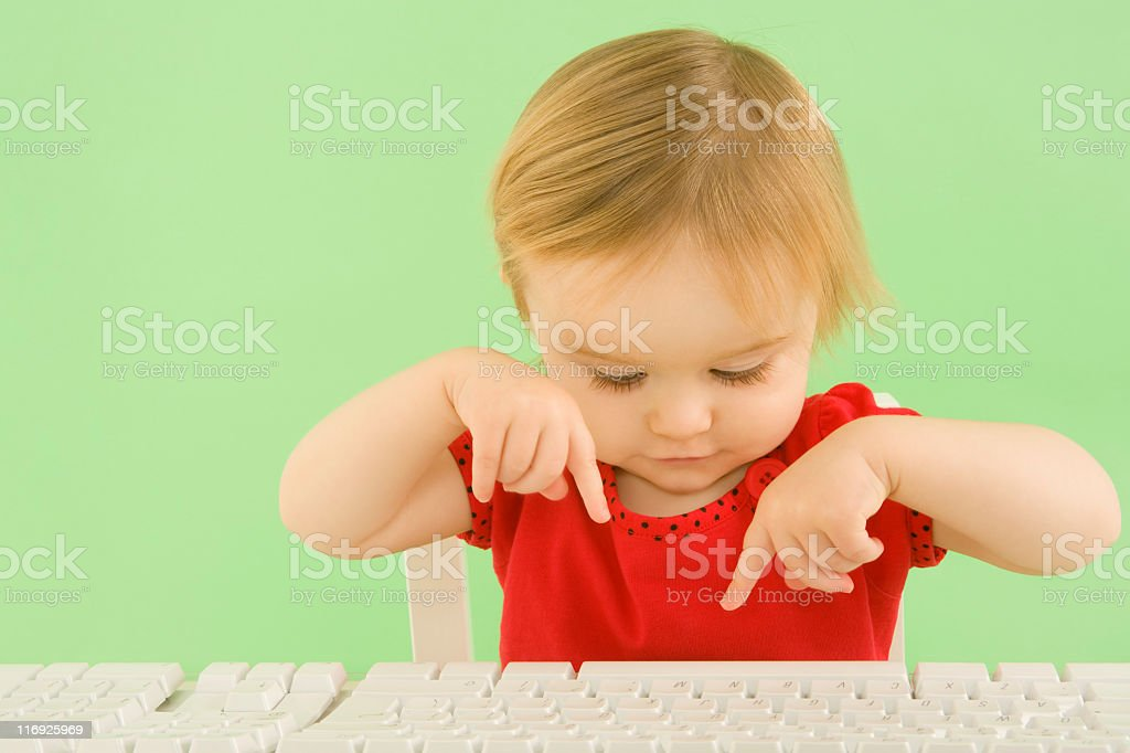 Young child typing on keyboard (XXL) royalty-free stock photo