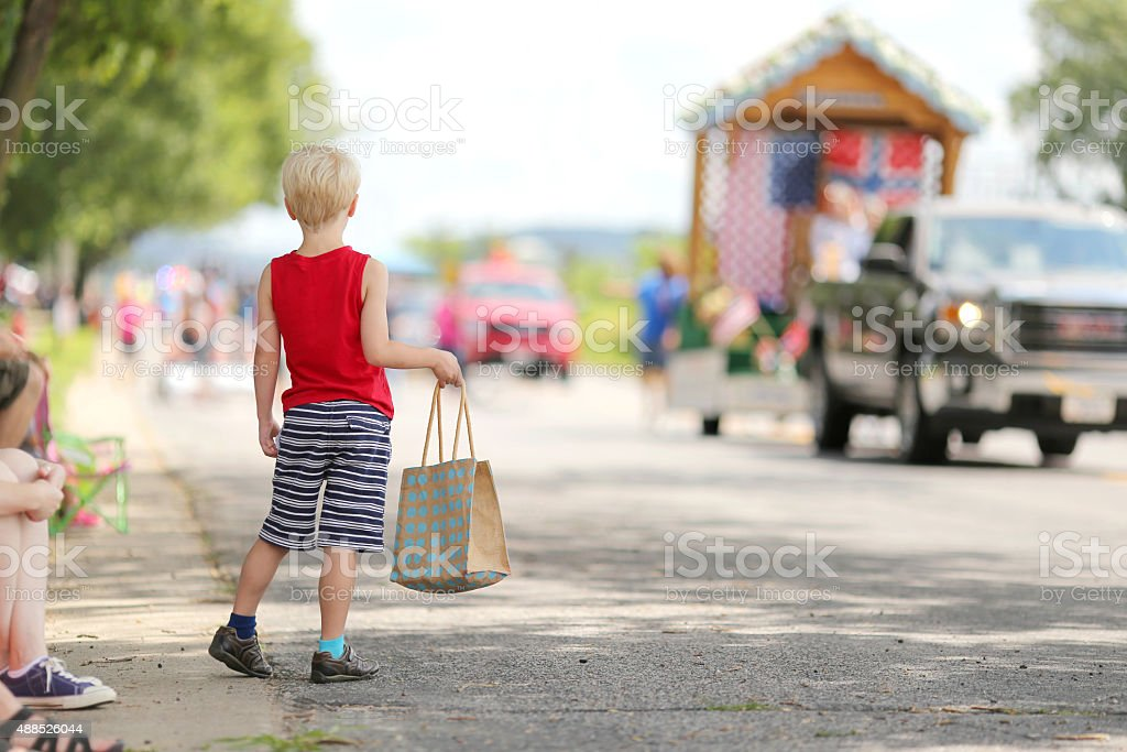 Young Child Watching Small Town America Parade stock photo