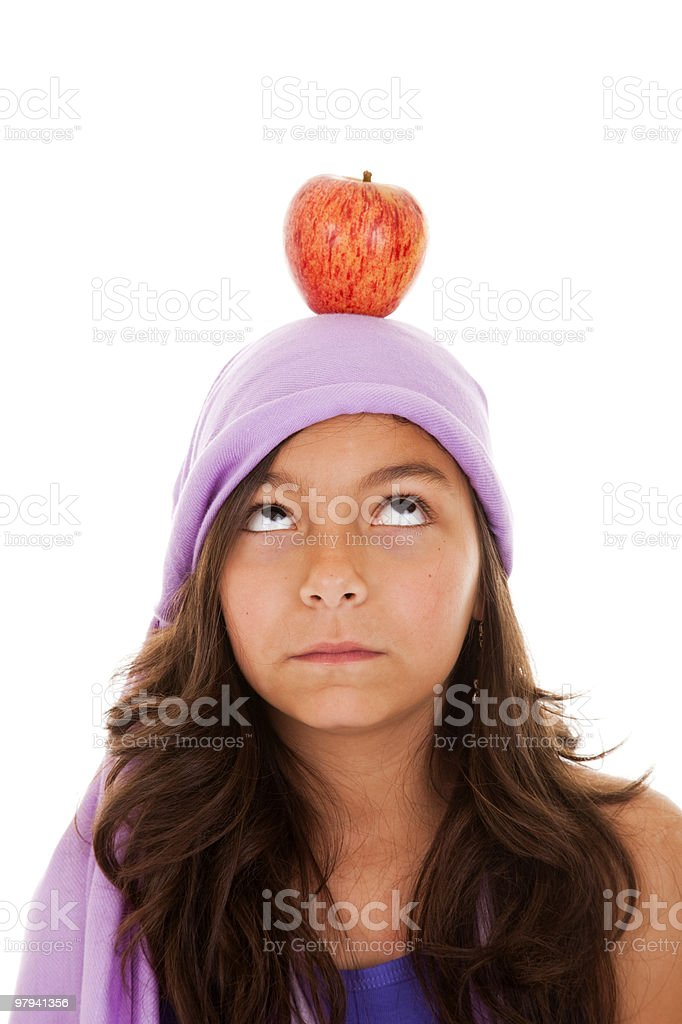 young child with an apple on her head royalty-free stock photo