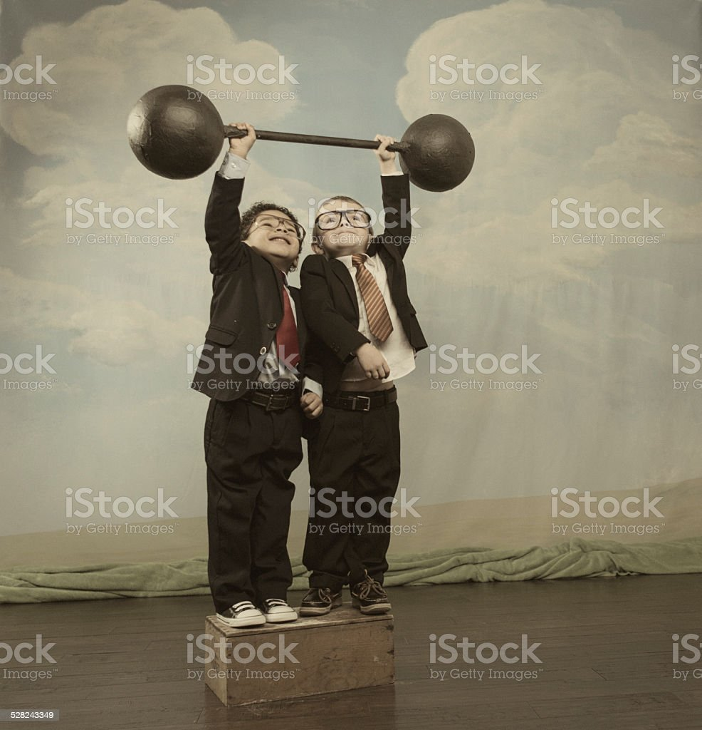 Young Children and Business Team Lift Barbell stock photo