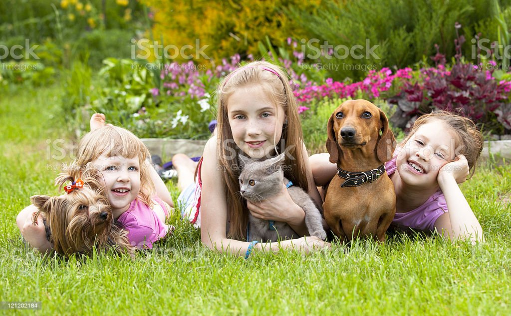 young children  and  pet dogs royalty-free stock photo