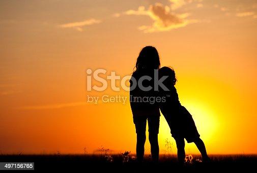 585604690istockphoto Young Children Bonding at Sunset 497156765