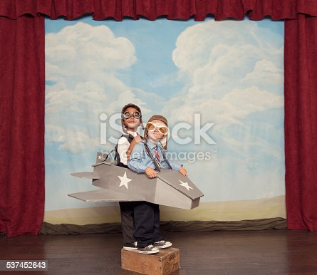 istock Young Children Dressed as Busnissmen in Toy Airplane 537452643
