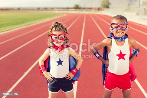 istock Young Children dressed as Superheroes Standing on Track 533462187
