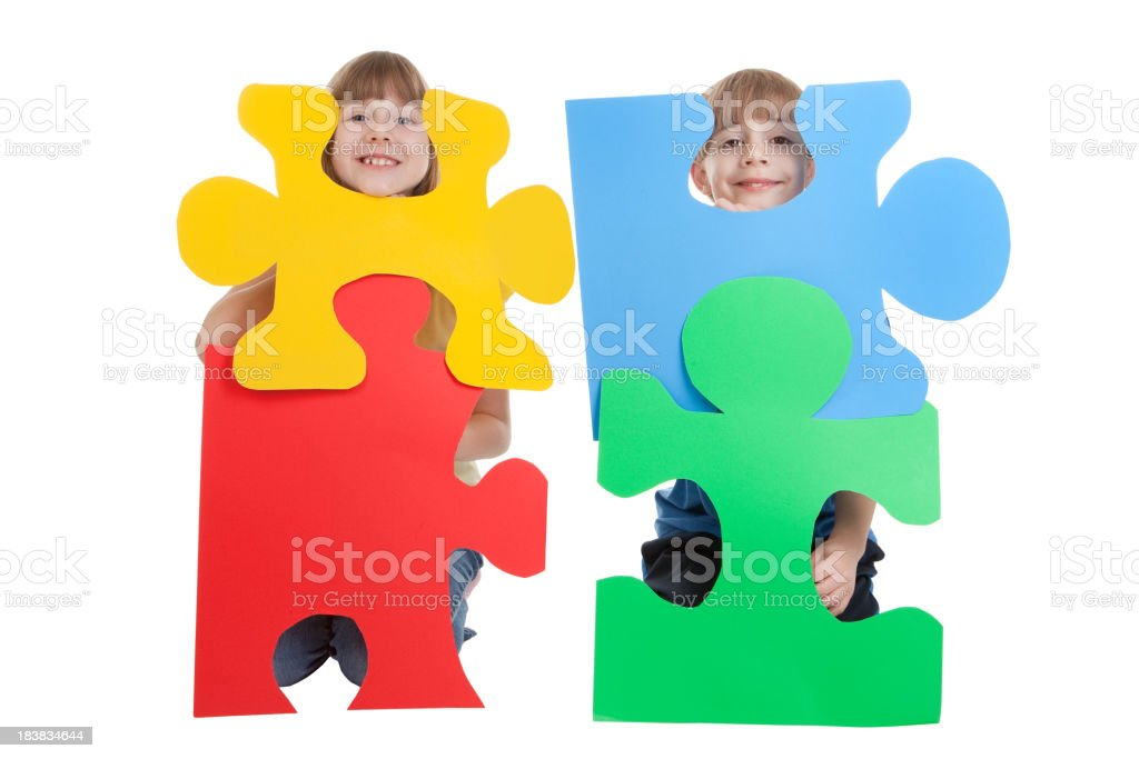Young Children Holding Colorful Puzzle Pieces stock photo