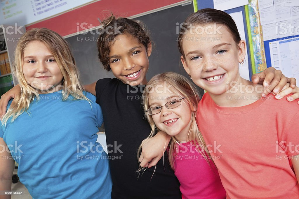 Young Children in Class With Arms Around Each Other royalty-free stock photo