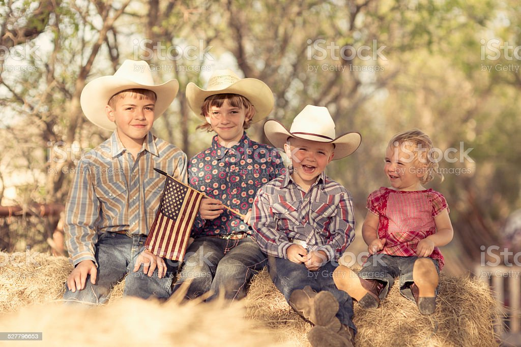 Young Children in Western Wear hold American Flag stock photo