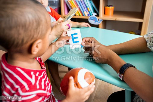 istock Young children learning the English alphabet with their parents 1074133748