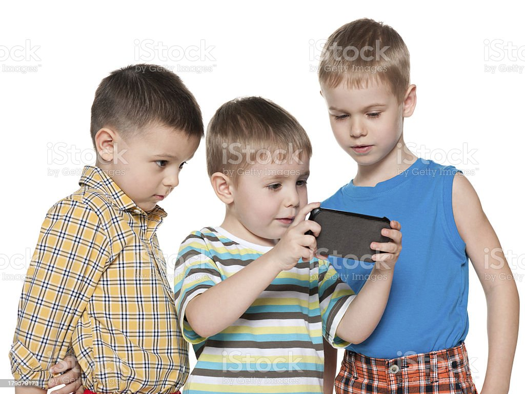 Young children plaing with a new gadget royalty-free stock photo