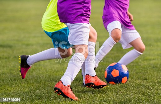 istock Young children players match on soccer field 961749064